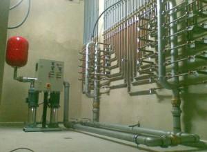 Baterías contadores agua con grupo de presión